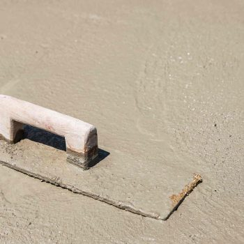 Photo of a trowel sitting on a freshly poured concrete slab in Wendouree by Ballarat Pro Concreters