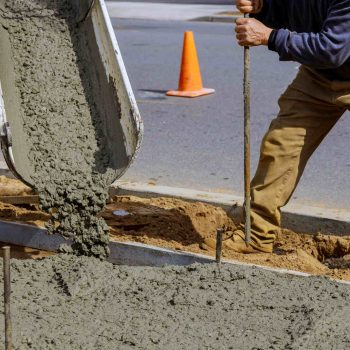 Photo of a team member from Ballarat Pro Concreters pouring a concrete driveway in Redan, Ballarat.
