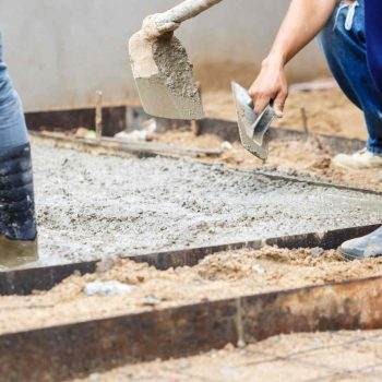 Image is of a concreter in Ballarat working on a slab